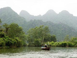Scenic landscape on the way to Perfume Pagoda, a popular day trip from Hanoi, Vietnam