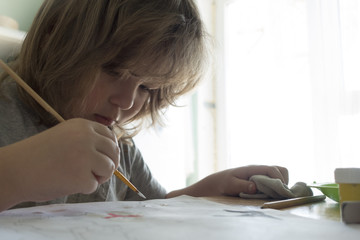 Children draw in home, Boy studying drawing at school