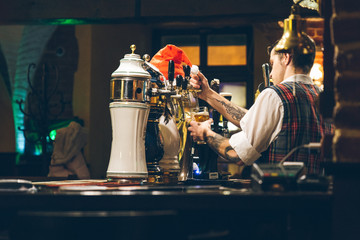 pub interior. evening time in bar. waiter at work