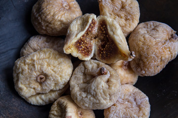 dry figs in rustic wooden bowl dry fruits
