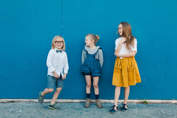Three Cute Kids Hanging Out on the Street, Talking and Laughing  Wall mural