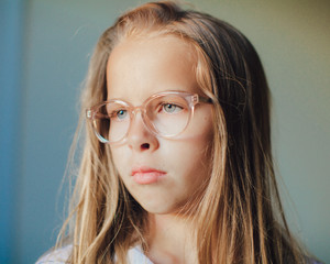 Portrait of a Young Girl with Long blonde hair Wearing Glasses