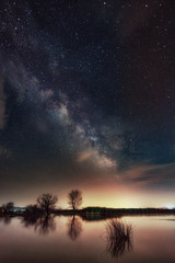 Milky Way over the lake. Milky Way galaxy over the Dojran Lake, FYR Macedonia. The night sky is astronomically accurate.