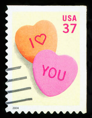 UNITED STATES OF AMERICA - CIRCA 2004: An I love you stamp printed in the USA shows two hearts, circa 2004