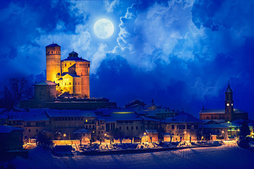 Serralunga castle during a cold winter night with snow in langhe region, Italy
