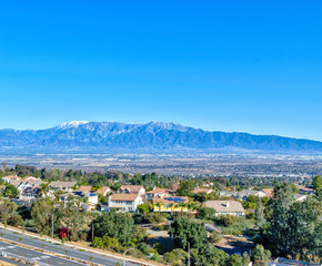Snow on distant mountains in Southern California suburbs