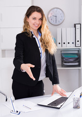 Cheerful businesswoman in suit working