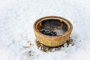 Fire bowl heating in a cold snowy winter.