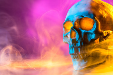 Skull in the smoke. Clouds of smoke. Death of a person from bad habits.