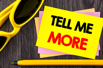 Conceptual hand text showing Tell Me More. Business photo showcasing Advice Guidance Curiosity In Coaching written on Stiky Note Paper with Pen on the wood background.