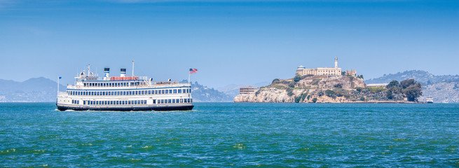 Alcatraz Island with historic excursion boat, San Francisco, California, USA