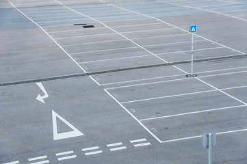 Car park with empty parking lot