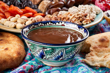 Traditional Azerbaijan sweet cuisine of holiday Nowruz: national dessert Sumalak, assortment of nuts and dry fruits