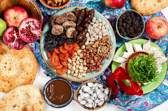 Traditional Azerbaijan sweet cuisine of holiday Nowruz. Fresh green grass samani symbol of spring