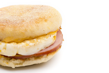 Egg, Canadian Bacon and Cheese Breakfast Sandwich on a White Background