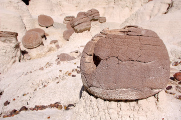 Round, pitted, natural sandstone rocks in the desert badlands of Bisti/De Na Zin in Northern New Mexico