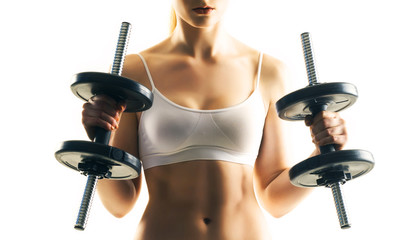 Sporty woman training with dumbbells isolated on white. Sport, health and fitness concept.