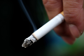 smoking a cigarette.Health and Care Concepts