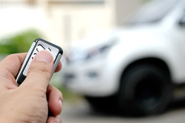 Man hand car remote control car door open.Technology concept And travel