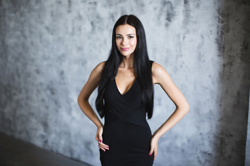 Beautiful woman in black dress.