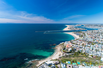Aerial view of coastal Newport Beach in Orange County, California, USA with coast, sand and blue skies. Wall mural