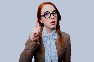 young redhead teacher with round glasses