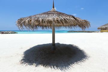 Grass umbrella on perfect beach