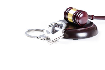 Wooden judge gavel and police handcuffs