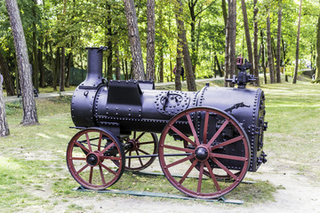 Restored steam engine for agricultural works. A historical monument of the nineteenth century, standing in the city park. Podlasie, Poland.
