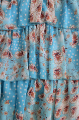 Chiffon flounces in blue. Transparent summer fabric for textiles