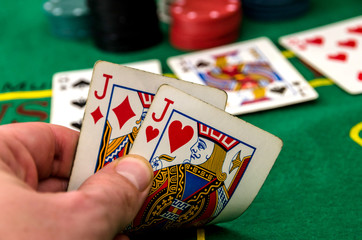 A poker player with two jacks close-up
