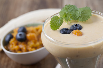 Smoothies with cloudberries, a banana and a blueberry