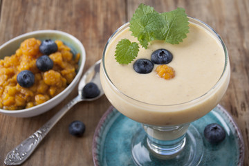 Smoothies with cloudberries and a blueberry