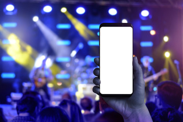 Taking photos of music concert with a mobile phone. Isolated screen for mockup.