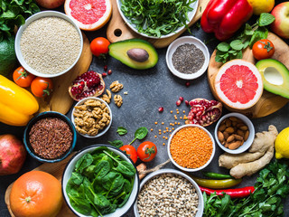 Fresh raw ingredients for healthy cooking. Vegetables, fruit, seeds, cereals, beans, spices, superfoods, herbs. Top view. Diet or vegetarian food concept. Copy space