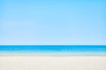 Blurred picture of a beach on a sunny day, nature background