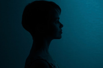 Silhouette of a girl with short hair studio portrait