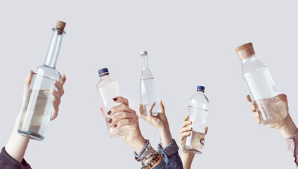 Different people holding water bottles