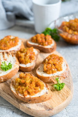 Toasted bread with vegetable caviar, made of squash, pumpkin, tomato, carrot