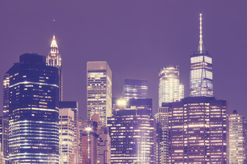Manhattan skyscrapers at night, color toned picture, New York City, USA.