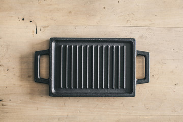 Kitchen tool grill wooden background