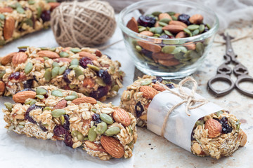 Homemade granola energy bars with figs, oatmeal, almond, dry cranberry and pumpkin seeds, healthy snack
