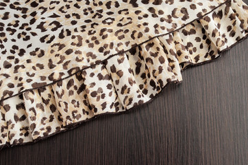 Background in a brown tone with a leopard texture