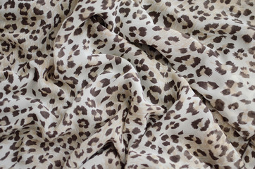 Chiffon fabric with leopard print. Closed Background