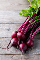 Fresh organic beet, beetroot on grey rustic wooden background. Top view. Copy space.