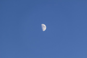 Moon against the blue sky