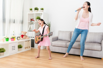 Both mom and daughter enjoying the music.