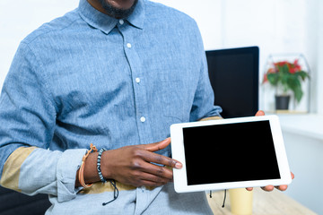African american man showing digital tablet screen