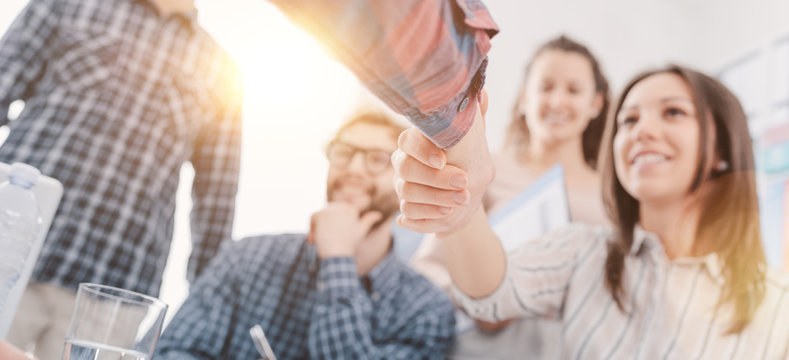 Partnerships and startups: business people shaking hands