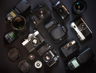 Photograph Workplace Concept. Collection Vintage Film And Digital Cameras, On Black Background, Top View